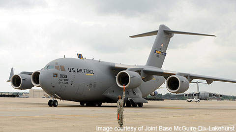 A C-17 Globemaster III cargo plane at the base.