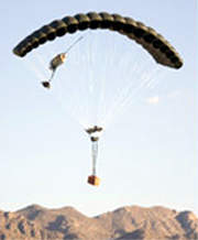 Cargo being air dropped from a military aircraft