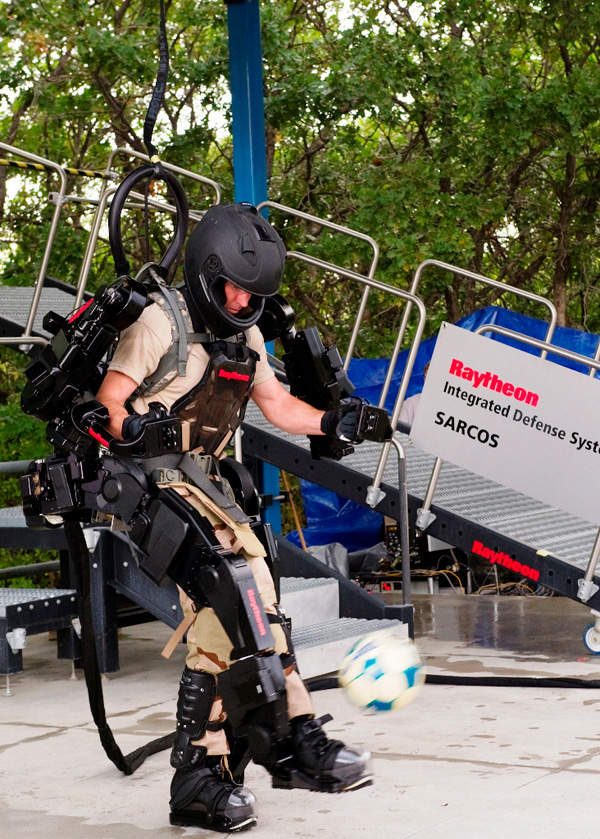 The XOS 2 is designed with high agility. It can climb stairs or ramps, use a punching bag, or play a with a football. Image courtesy of Raytheon Company.