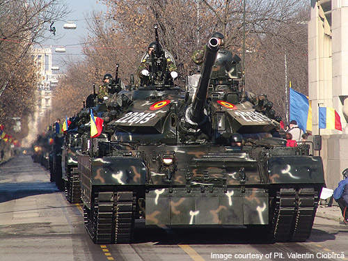 A convoy of TR 85 M1 Bizonul tanks during a military parade in Bucharest.