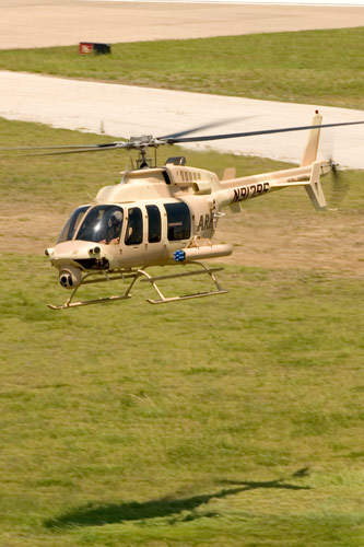 Low flying ARH-70A armed reconnaissance helicopter required by the US Army