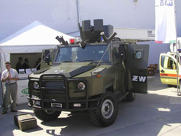 A Dzik-2 armoured vehicle mounted with a rotating machine gun turret on the roof.