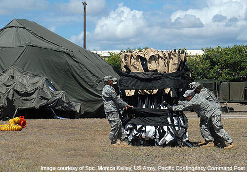 US Army Pacific Contingency Command Post Soldiers unfold a Deployable Rapid Assembly Shelter or DRASH tent during Exercise Autumn Laulima.