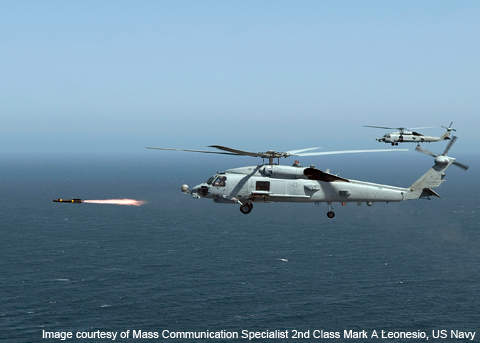 An MH-60R Seahawk of the US Navy fires the first of four live Hellfire II missiles.