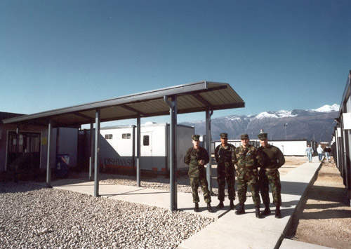 Military personnel outside camp