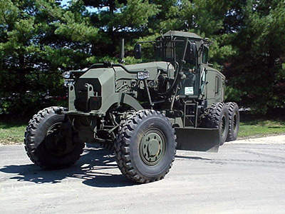 Military specification tractor with motor grader