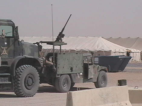 Military artillery armed with armoured plate