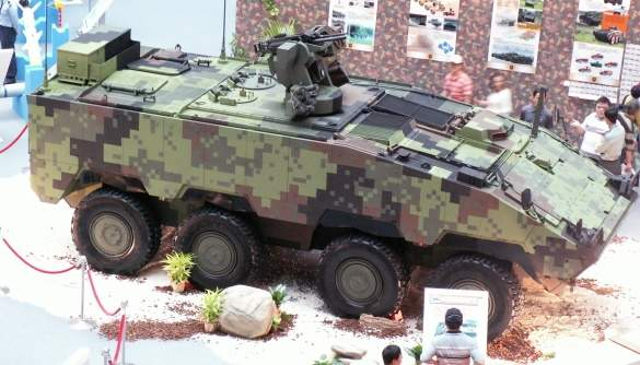 The CM-32 Yunpao (Clouded Leopard) troop carrier configuration on display at an exhibition.