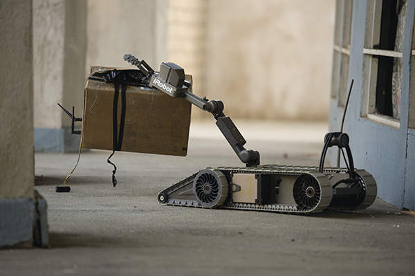 The 310 SUGV features a manipulator arm to identify and neutralise hazardous objects. Image courtesy of iRobot Corporation.