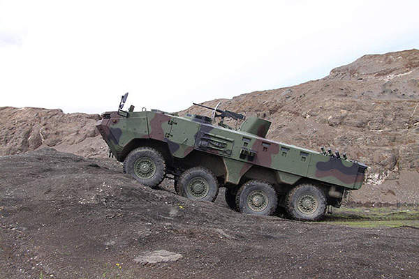 A side view of the ARMA 8x8 armoured tactical vehicle.