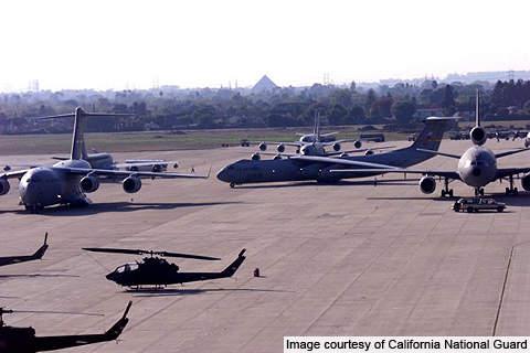 Several Aircraft parked at Los Alamitos Army Airfield.