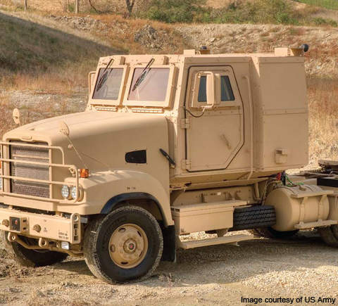 The M915A5 line-haul tractor features modular, add-on armour kits.
