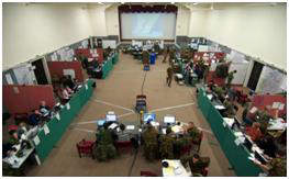 Hall full of military officers undertaking training