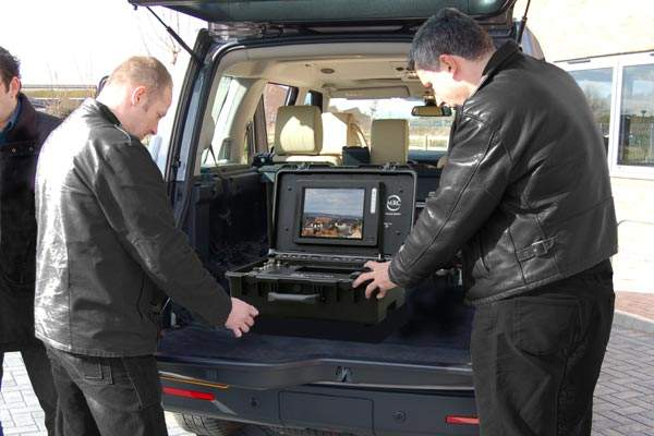 Compact video equipment being loaded into vehicle