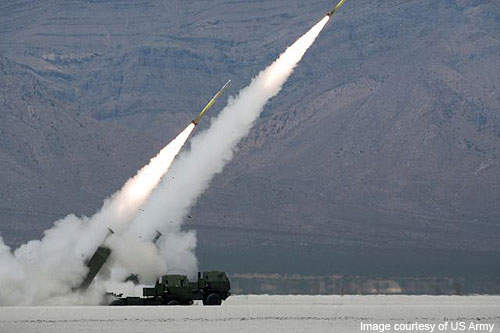Two high-mobility artillery rocket system launchers being fired at White Sands Missile Range.