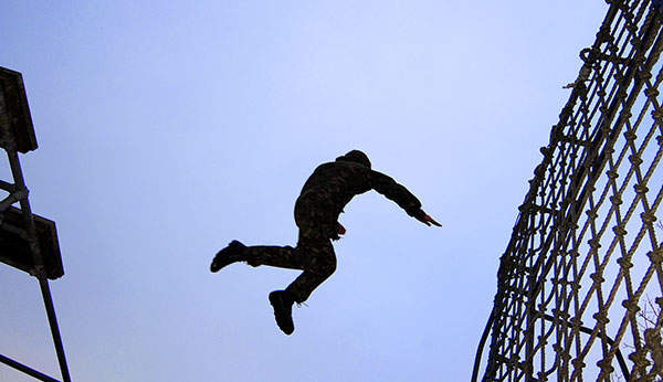 A soldier undertaking an aerial assault course at Catterick Garrison, Crown Copyright.