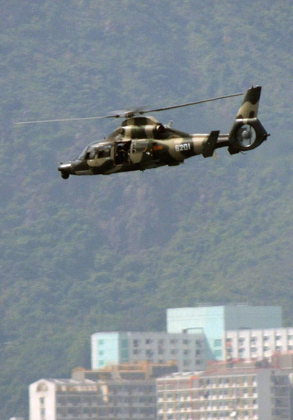 Harbin Z-9W attack helicopter can be armed with  anti-tank missiles, cannons, machine guns and 57mm rocket launchers. Image courtesy of Tksteven.