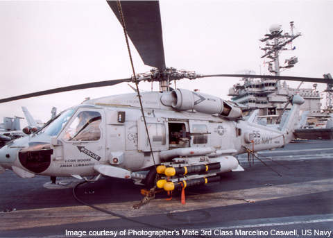 An SH-60 Sea Hawk, armed with AGM-1148 Hellfire air-to-ground missiles.