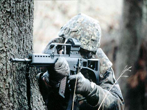 IdZ equipped soldier taking aim with his Heckler & Koch 5.56mm calibre G36 assault rifle