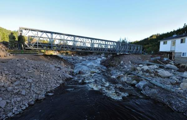 A bridge constructed by engineers from 4 Engineer Support Regiment, Gagetown, and 56 Engineer Squadron, from St. John's Newfoundland, as part of Operation Lama undertaken in response to Hurricane Igor in Newfoundland and Labrador. Image courtesy of the National Defence and the Canadian Forces.