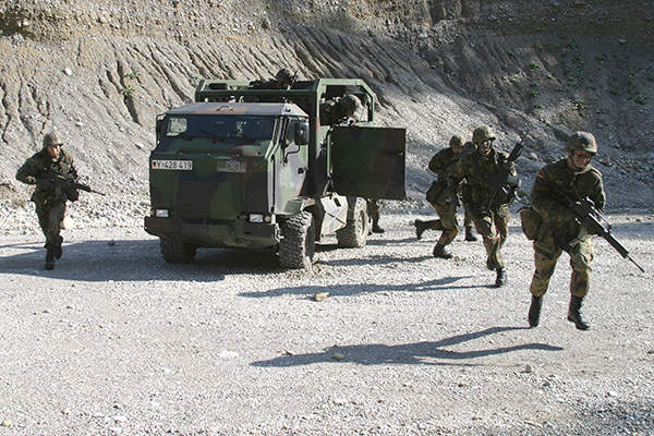 The armed infantrymen exit from the rear compartment of the Mungo armoured multi-role transport vehicle. Image courtesy of Krauss-Maffei Wegmann.