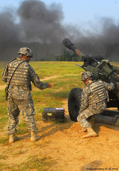 A M119 Howitzer being fired during a live-fire exercise.