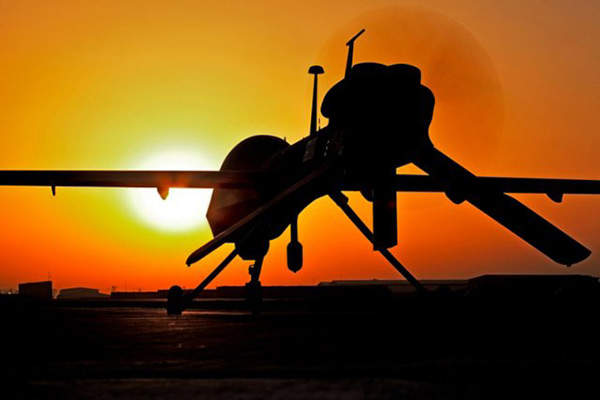 The Gray Eagle unmanned aircraft system waits for its mission at sunset during Operation Enduring Freedom in Afghanistan. Image courtesy of U.S. Army.