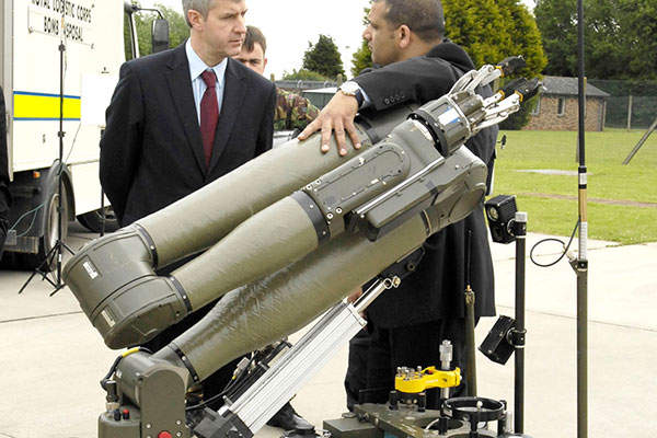 Northrop Grumman officially displaying the prototype of CUTLASS robotic vehicle to Under-Secretary of State for Defence, Derek Twigg MP. Image courtesy of Northrop Grumman Corp.