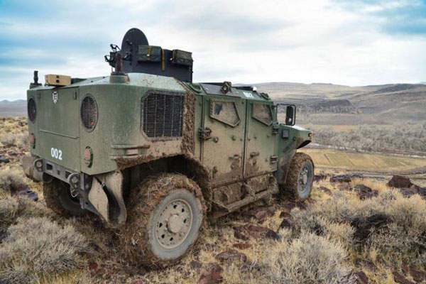 The front and rear steel frames of the vehicle, extending directly from the cab, create a monocoque structure. Image courtesy of US Army TARDEC.