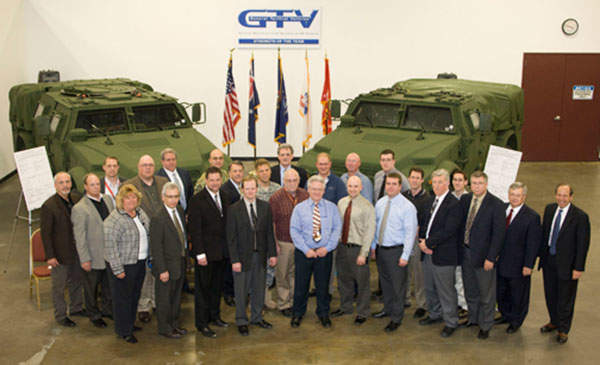 The General Tactical Vehicles (GTV) JLTV team members pose with US and Australian Government officials.