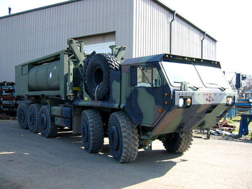 US Army vehicle carrying a water supply tank