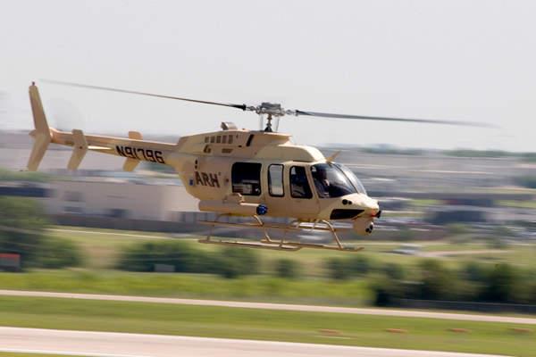 The Militarised ARH in flight showcasing its Honeywell turboshaft engine