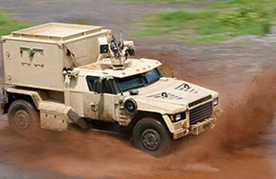 Military Vehicle Featuring Additonal Protection for Compartments and Tires