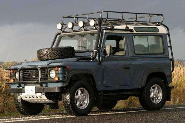 A Defender 90 with expedition specification equipment including snorkel and sump protection.
