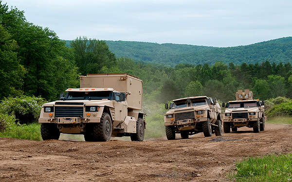 Three Lockheed Martin Joint Light Tactical Vehicle (JLTV) categories demonstrate their mobility on off-road conditions. Image courtesy of Lockheed Martin.