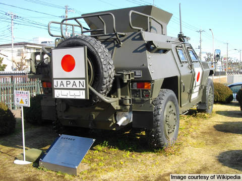 A close rear side view of the Komatsu LAV (Light Armoured Vehicle).