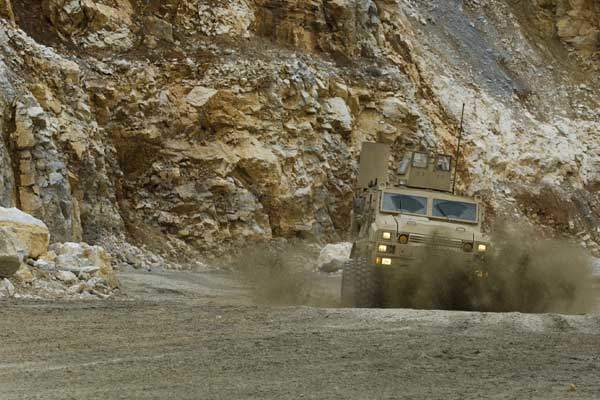 RG33 series vehicle driving in gravel conditions