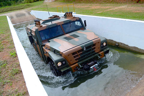 A TUPI 4x4 vehicle demonstrates its fording capabilities during a test by the Brazilian Army Evaluation Centre (CAEx). Image courtesy of Avibras.
