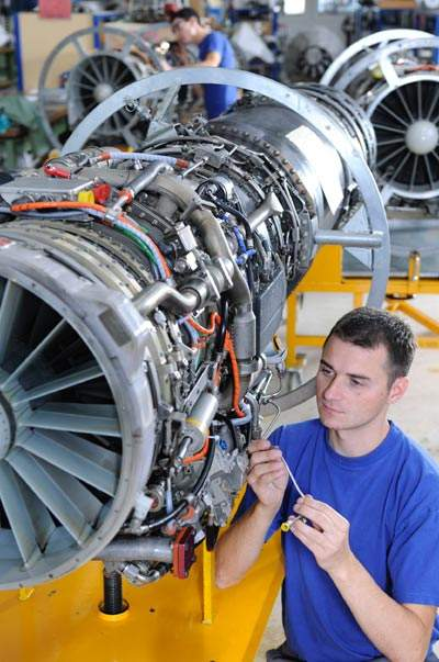Aircraft engine being inspected by engineer