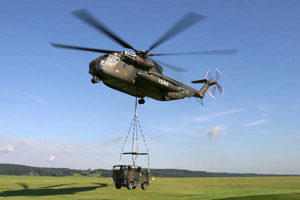 An International Security Assistance Force (ISAF) helicopter lifts a Mungo armoured multi-role transport vehicle. Image courtesy of Krauss-Maffei Wegmann.
