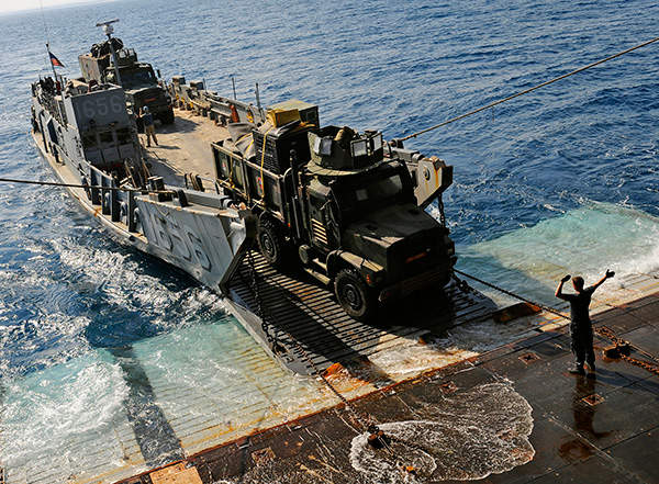 A medium tactical vehicle replacement rolls-off from Landing Craft Utility (LCU) during Bright Star 2009. US Navy photo by Mass Communication Specialist 2nd Class Kristopher Wilson.