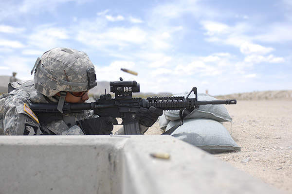 A soldier from the US Army fires at a target during an M4 qualification range at Fort Irwin. Image courtesy of SGT Giancarlo Casem.