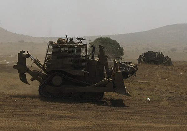An Armoured D9R Dozer armed with an FN Mag machine gun performs during IDF training. Image courtesy of Michael Aronov.