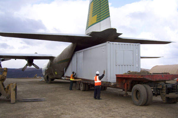 Plane loading a modular camp unit