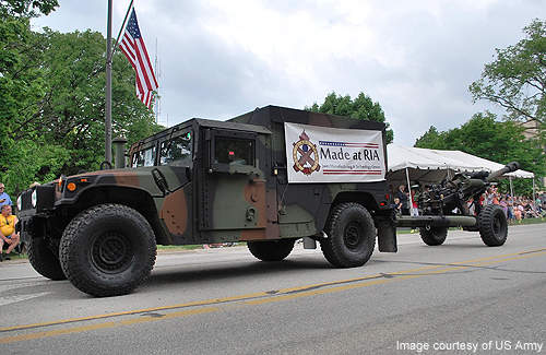 A M119 Howitzer built by the Joint Manufacturing and Technology Center is towed during the Rock Island Arsenal Armed Forces Day Open House parade. Credit: US Army.