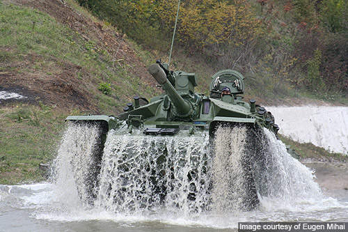 A TR 85 M1 MBT demonstrates its fording capabilities at the Mihai Bravu firing range.