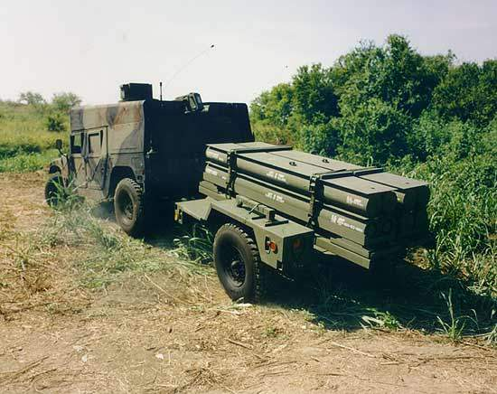 LOSAT towing missiles on a trailer set up