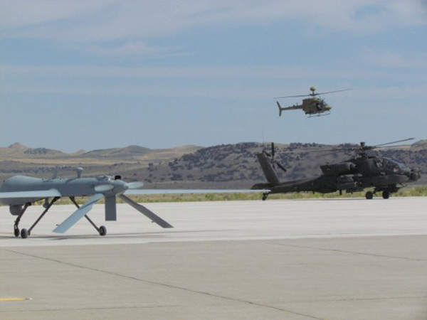 A Gray Eagle sits on the tarmac along with 'Apache and Kiowa' at Dugway Proving Ground.  Image courtesy of Ms Kari Hawkins ( Redstone).