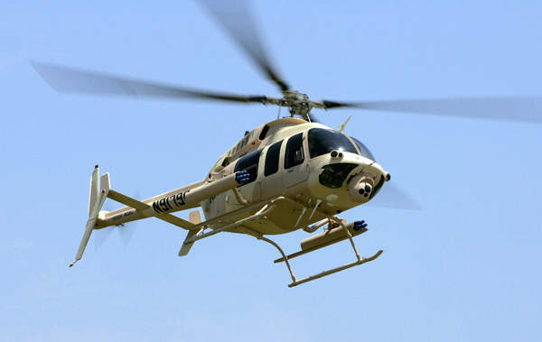 The ARH-70 helicopter in flight Common Avionics Architecture System (CAAS) avioinics suite