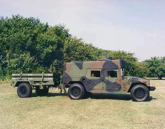 Side view of  LOSAT towing missiles on a trailer set up